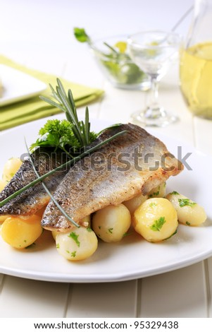 Pan fried trout fillets with potatoes  - stock photo