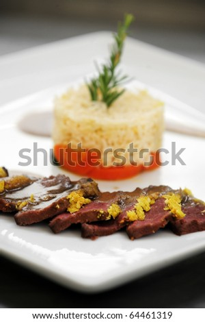 Pan fried venison with a coconut crust - stock photo