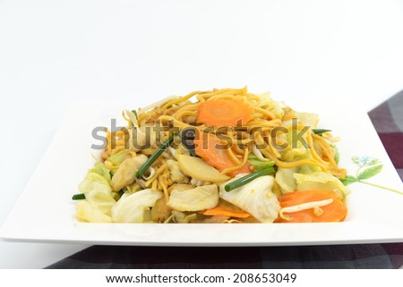 "Pan Fried Yellow Chinese noodle call ""chow mein"" contains cabbages, bamboo shoots, baby corn,straw mushrooms,carrots,celery,bean sprouts"