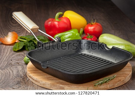 Pan on the wooden table - stock photo