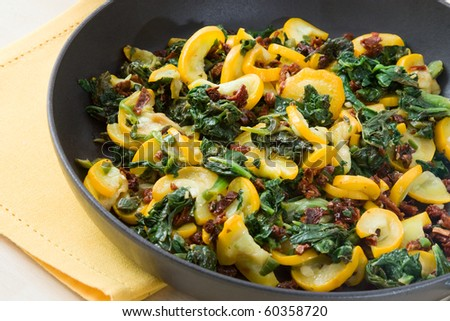 Pan with fried zucchini and spinach.