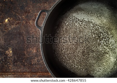 Pan with melted butter on the metal background top view