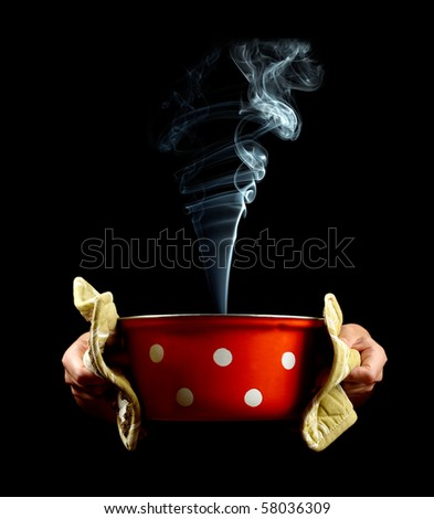 Pan with smoke in hands - stock photo
