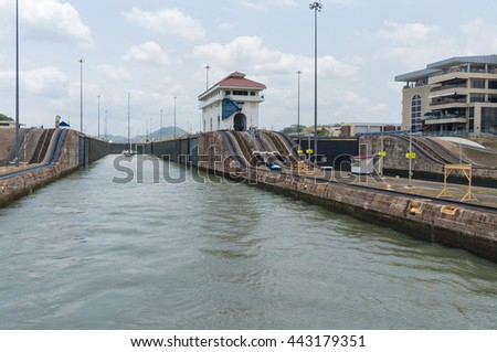 PANAMA CANAL, PANAMA - APRIL 13, 2013: View of the Miraflores Locks, one of the three locks that form part of the 'old' Panama Canal. On the right side is the Visitor Center.