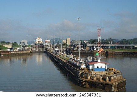 Panama canal, Panama-May 16, 2009: Gates and basin of GATUN LOCKS  of Panama canal filling to raise a ship. This is the first set of locks situated on the Atlantic entrance of the Panama Canal.  - stock photo