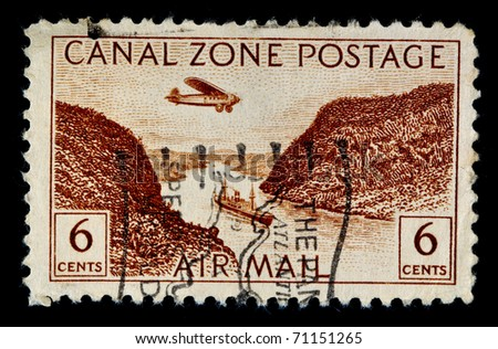 PANAMA CANAL ZONE - CIRCA 1983: A stamp printed in Panama Canal Zone Panama Canal Zone floating on the canal boat and airplane circa 1983