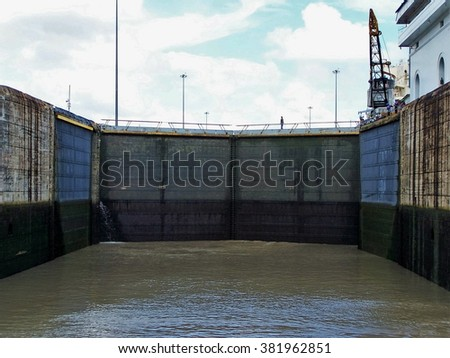 PANAMA CITY, PANAMA - CIRCA OCTOBER 2011: Gate of the lock in the Panama Canal, water level low, seen from the deck of a boat - stock photo