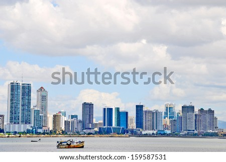 PANAMA CITY, PANAMA, DECEMBER 20 2006. A ship in the sea and skyscrapers in the horizon, in Panama City, on December 20th 2006. - stock photo