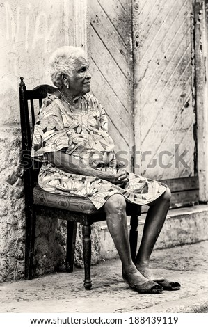 PANAMA CITY, PANAMA, JANUARY 9, 2012: Unidentified Panamian woman sits on a chair on the chair. 70% of the Panama people are mestizos - stock photo