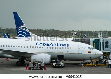PANAMA CITY, PANAMA - MAY 8: Copa Airlines plane parks at the gate ready for boarding in Panama City, Panama on May 8, 2014. Copa Airlines is the main Panama airline. - stock photo
