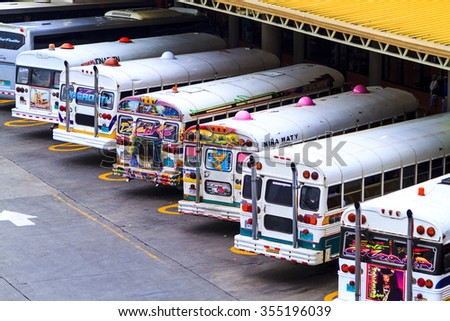 PANAMA CITY, PANAMA, OCTOBER 21 2015. Painted and colorful public busses in Panama City Main Bus Station.  Provides the backbone of personal, affordable  long distance transportation for the public.  - stock photo