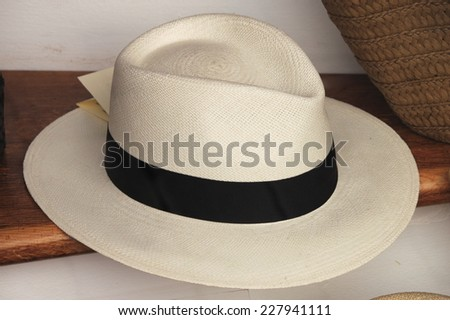 Panama hat for sale in a market stall - stock photo