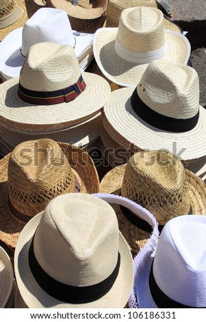 Panama hats for sale in a market stall - stock photo