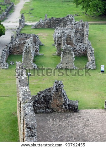 Panama La Vieja, old Spanish city UNESCO heritage ruins. At far is seen the Bishop House, also known as Pedro Alarcon house, and closer part of the cathedral ruins connected to the tall bell tower. - stock photo