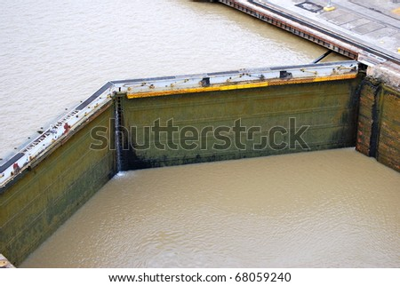 PANAMA - OCTOBER 6. In July 2009, the Panama Canal Authority awarded contracts to a consortium of companies to build six new locks by 2015. Old, narrow lock gates Balboa. October 6, 2010, Panama - stock photo