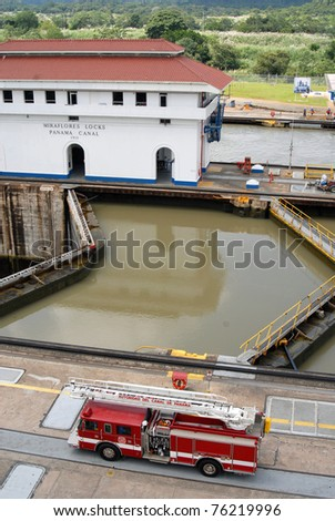 PANAMA - SEPTEMBER 10. Fire truck controls the safety at Miraflores Locks on September 10, 2006 in Panama Canal. In April 2011 a $43 Million Contract Awarded  for Construction of New Backhoe Dredge. - stock photo