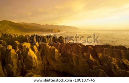 Panaroma of The Pancake Rocks at Sunset, New Zealand - stock photo
