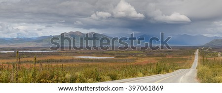 Panaroma view on the Dalton highway in the Alaskan landscape during autumn time - stock photo