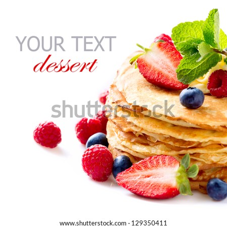Pancake. Crepes With Berries. Pancakes stack with Strawberry, Raspberry, Blueberry and Syrupe isolated on a White Background - stock photo