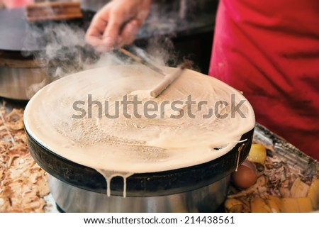 pancake made by a Paris street vendor - stock photo