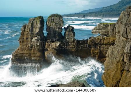 Pancake rock canyon at western coast in South Island, New Zealand - stock photo