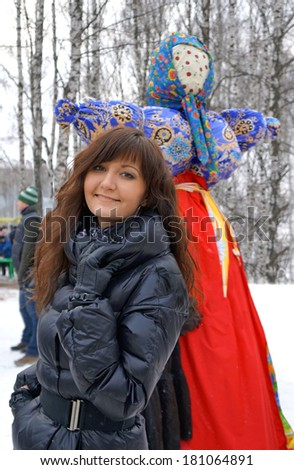 Pancake week holiday in Russia, young girl and countrywoman of straw  - stock photo