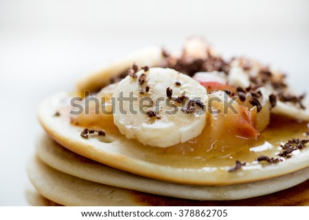 Pancake with banana apple and chocolate macro background