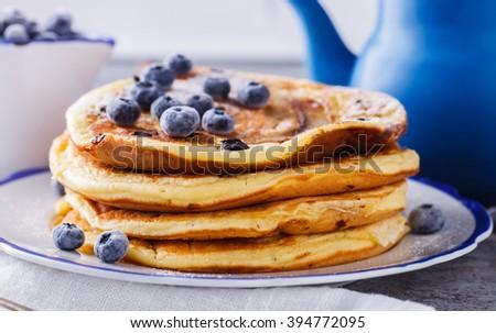 Pancake with banana , blueberries and honey. - stock photo
