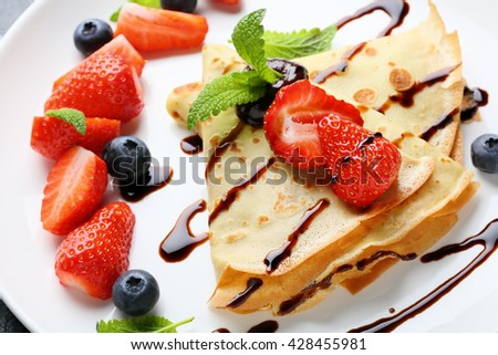 pancake with berries and chocolate, food close-up - stock photo