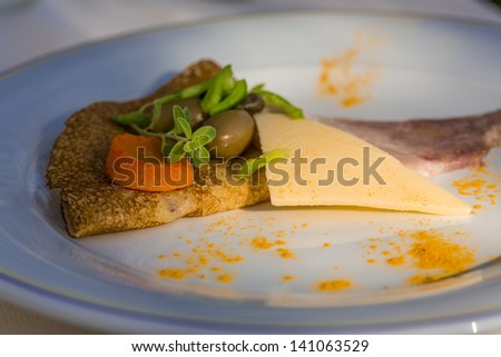 Pancake with cheese, olives and ham