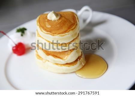 pancake with honey and strawberry - stock photo