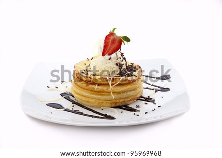 pancake with ice cream and chocolate topping with a piece of strawberry, isolated on white background.