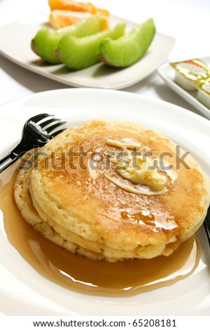Pancakes and honey - stock photo