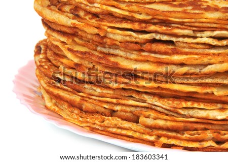 Pancakes on plate with sour cream