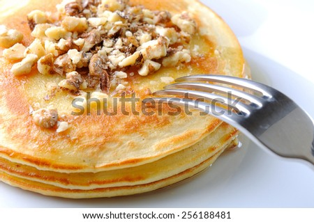 pancakes on white plate - stock photo