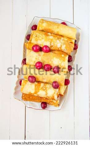 Pancakes stuffed with cottage cheese and berries