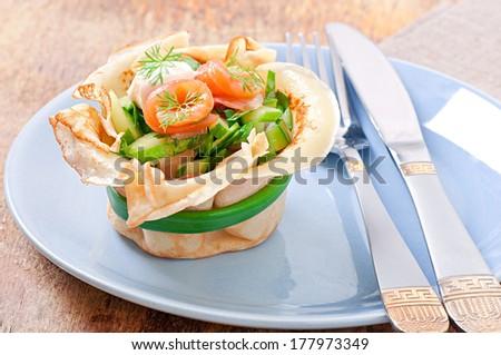 Pancakes tarts with salmon - stock photo