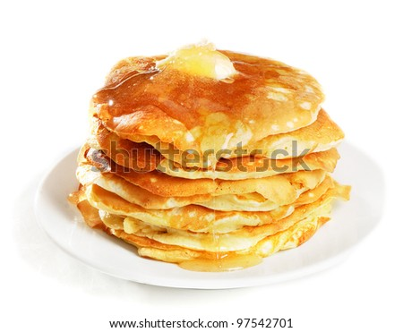 pancakes topped with honey - stock photo