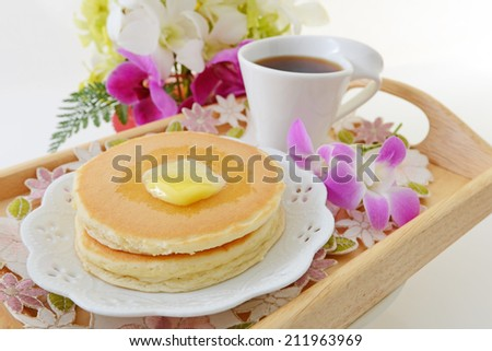 Pancakes with a cup of coffee - stock photo