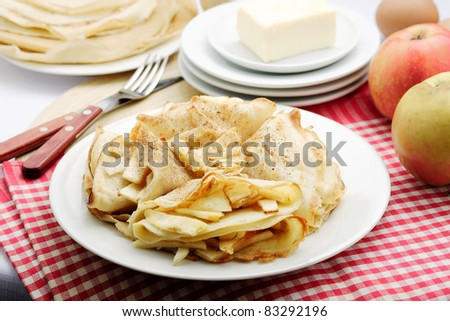 Pancakes with apples - stock photo