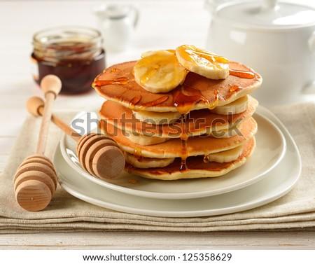 Pancakes with banana and honey - stock photo