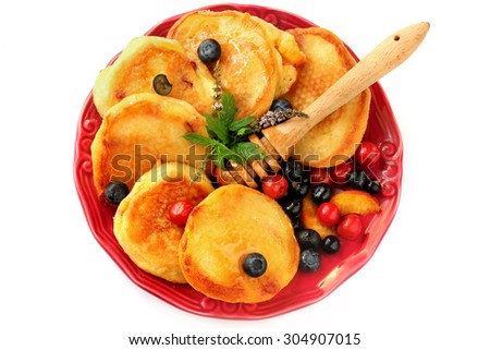 Pancakes with berries, fruits, honey on a plate isolated on white - stock photo