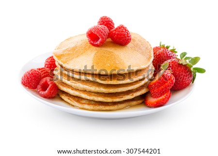 Pancakes with berries over white background.