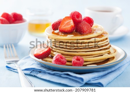 pancakes with berry and honey - stock photo