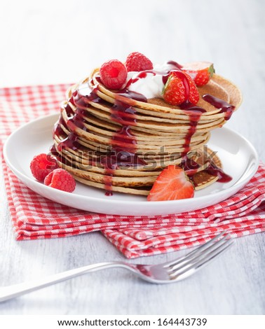 pancakes with berry and jam - stock photo