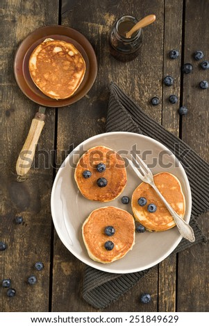 Pancakes with blueberries and a small pan - stock photo