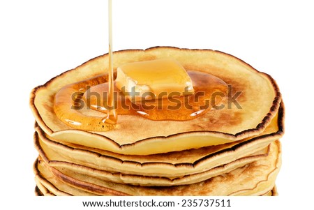 Pancakes with butter and syrup. Isolated on white background.
