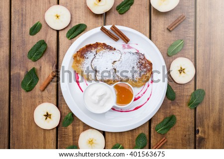 pancakes with cinnamon apples with honey and sour cream - stock photo