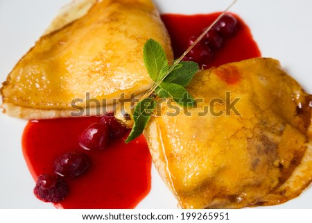 Pancakes with cottage cheese and berry sauce - stock photo