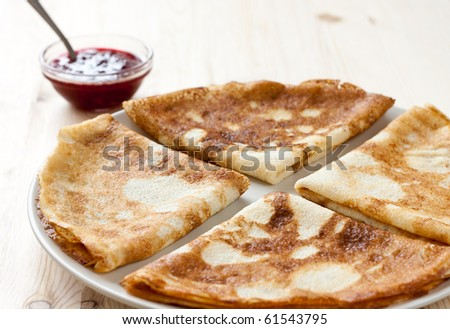 Pancakes with cranberry jam - stock photo